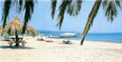 The long sandy beach is a perfect place to relax or have fun with a variety of watersports